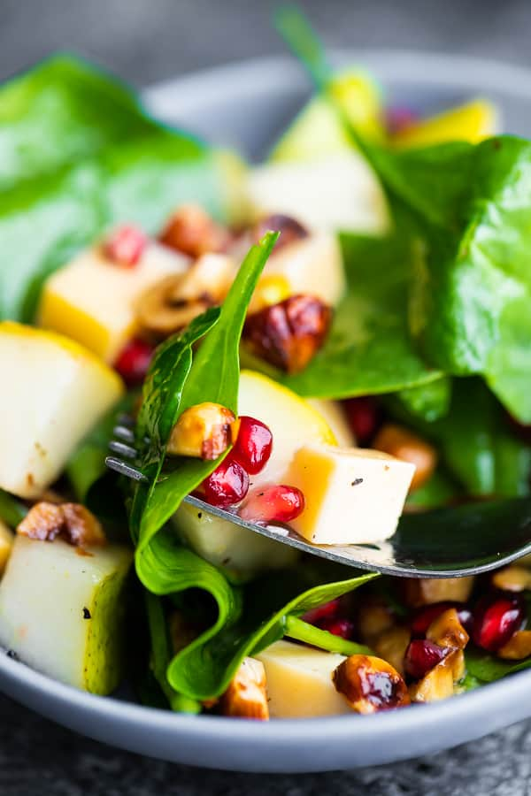 close up view of pear salad on fork