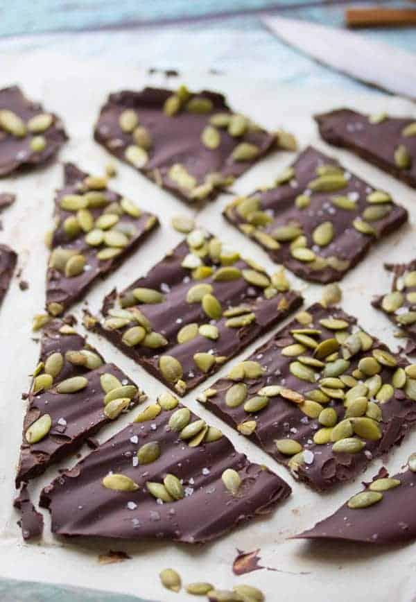 Mexican Chocolate Bark with pepitas on parchment paper