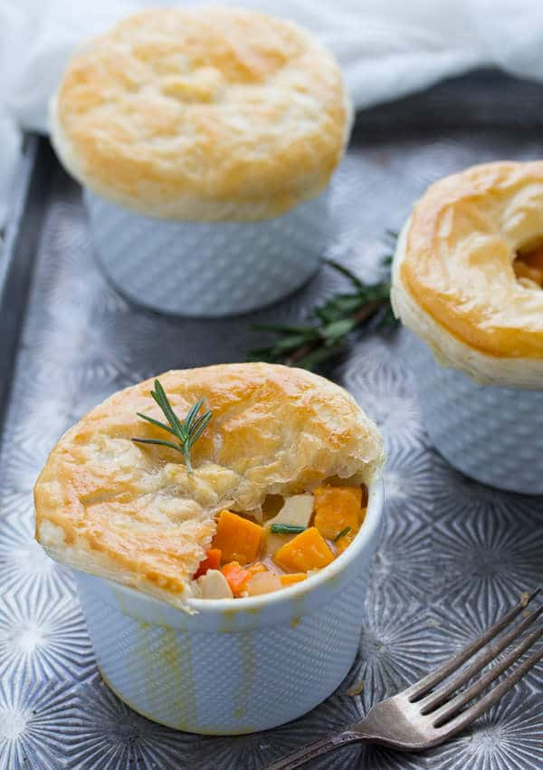 3 Rosemary Sweet Potato Chicken Pot Pies on baking sheet with pastry of one broken open