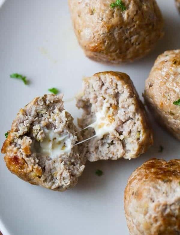 feta stuffed greek turkey meatballs on gray plate with one cut open