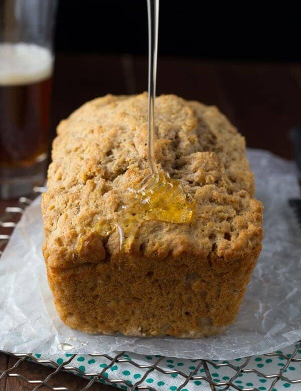 honey rye beer bread with honey drizzled on it