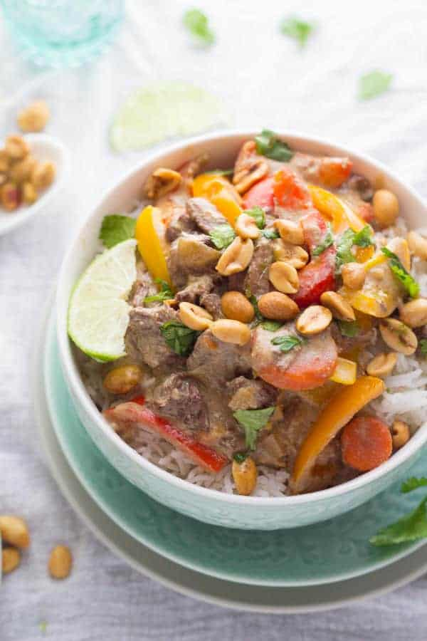 slow cooker thai curry beef in a bowl with rice