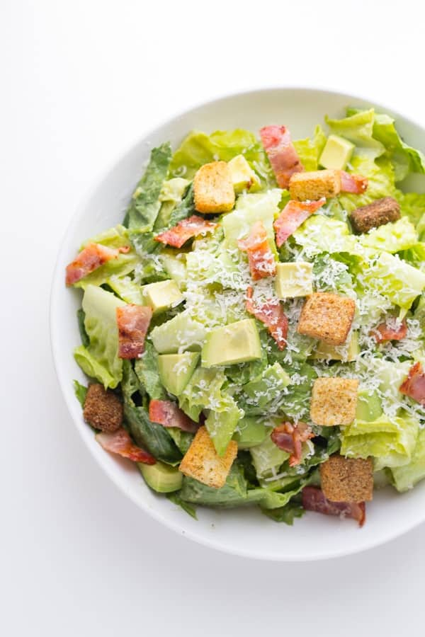 overhead shot of a bowl of avocado caesar salad