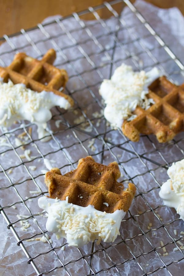 three carrot cake waffle bites drying on a wire rack