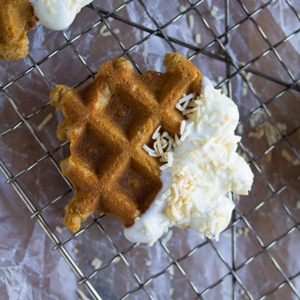 Carrot Cake Waffle Bites: carrot cake blondie batter is cooked up on the waffle iron, then dunked in a coconut-cream cheese frosting.