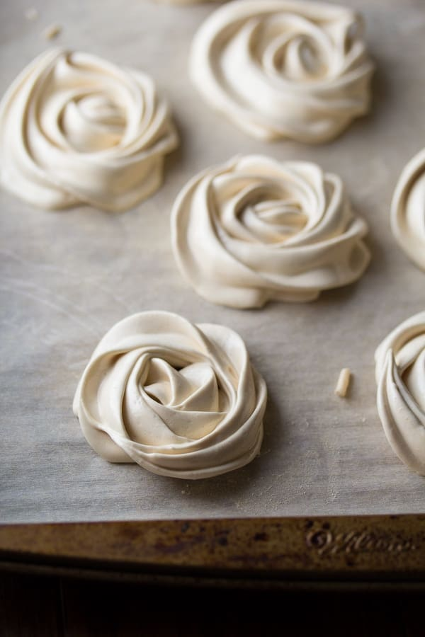 meringue cookies on parchment lined baking sheet before baking