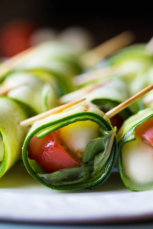 These grilled caprese zucchini roll ups are an easy appetizer, perfect for your next BBQ! All the flavors of caprese salad, wrapped in a zucchini ribbon.