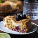blackberry lime cream cheese coffee cake slice on white plate with fork