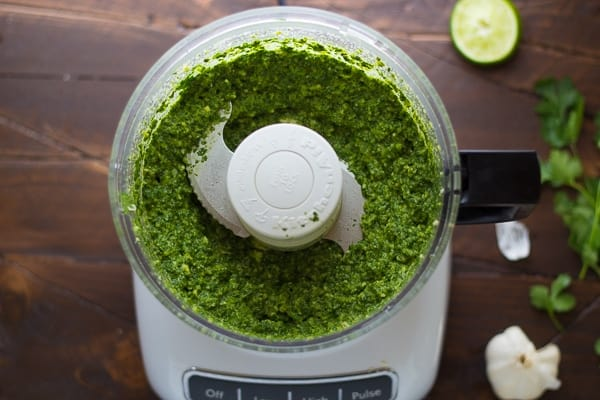 overhead view of the food processor containing the cilantro jalapeno pesto ingredients after blending