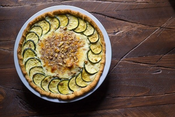 overhead view of zucchini ricotta quiche in pie plate