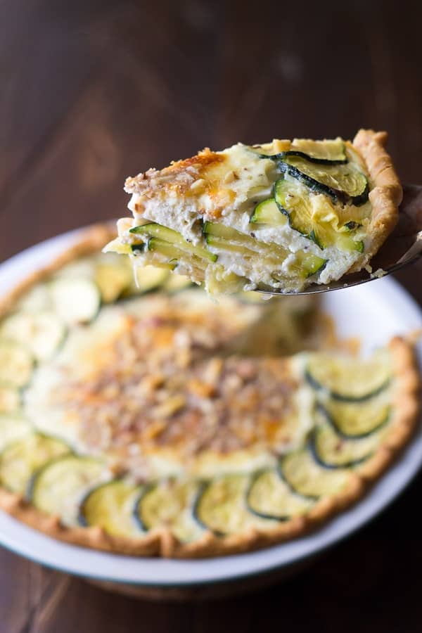 slice of zucchini ricotta quiche on a spatula