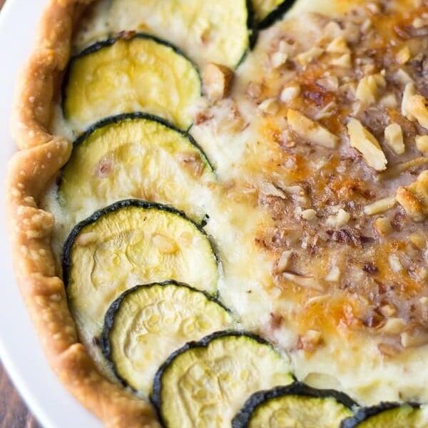 close up shot of zucchini ricotta quiche with crumbled walnuts