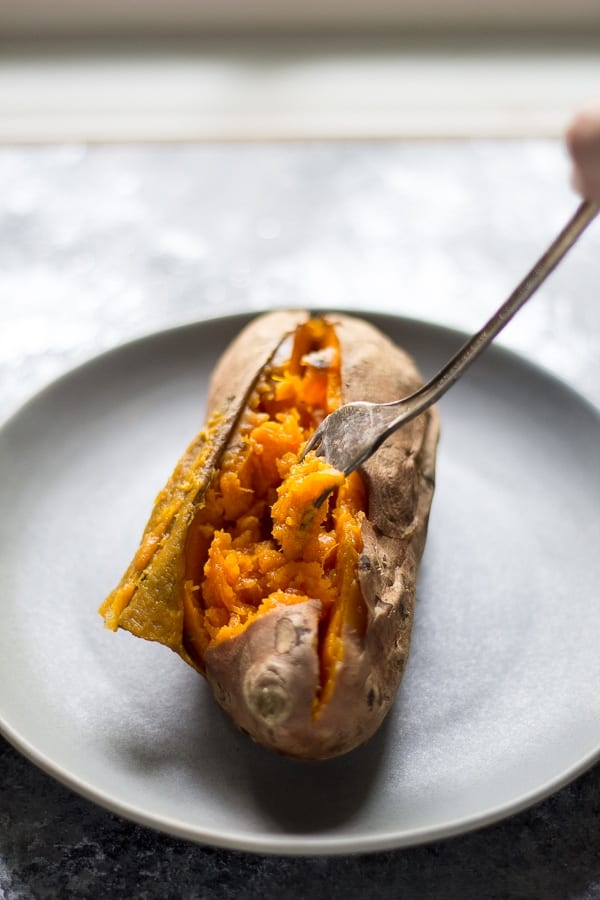 Crock Pot sweet potatoes with fork on a plate