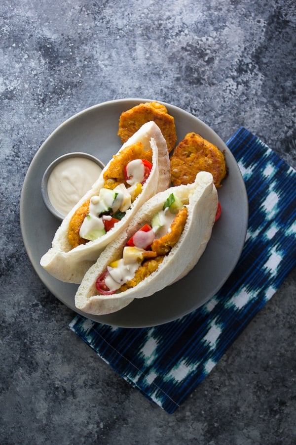 sweet potato falafels in two pitas with salad and tahini sauce