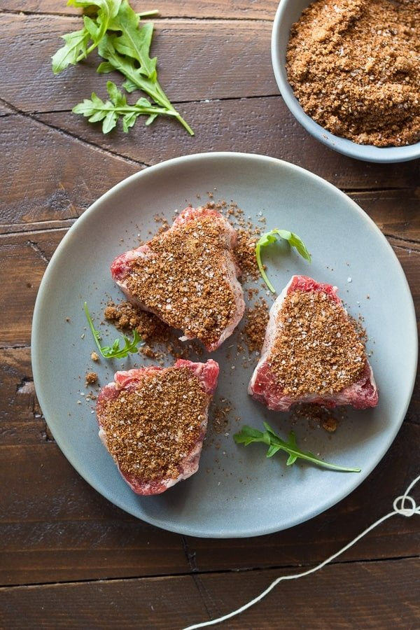 uncooked lamb chops seasoned with rub