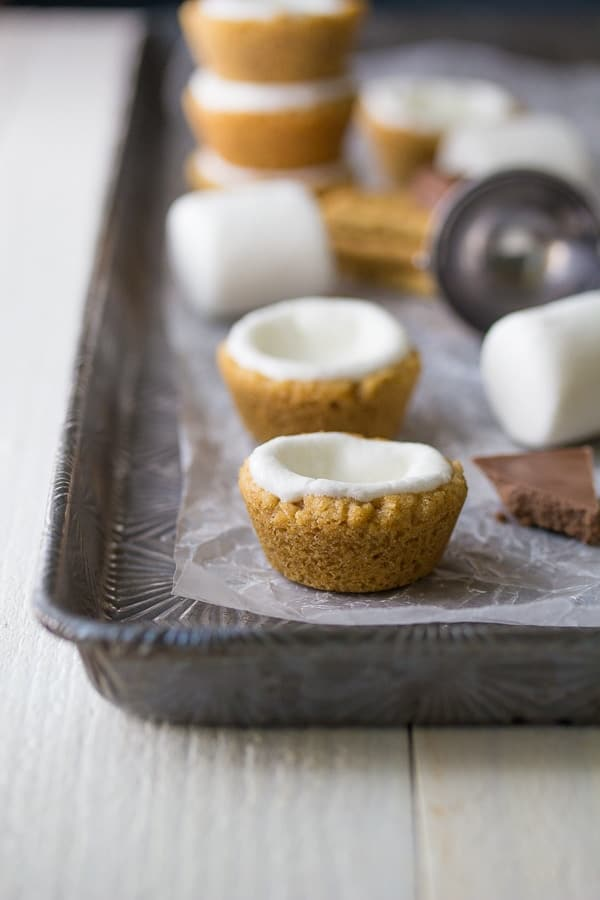 Ice Cream Cookie Cup shells on a sheet pan before adding in the ice cream