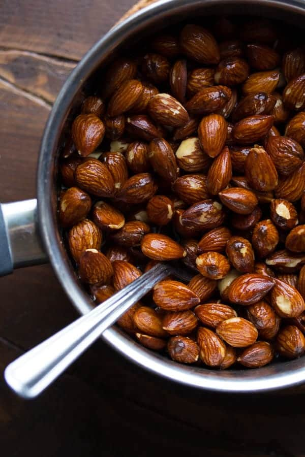 simmering the almonds in a honey mixture
