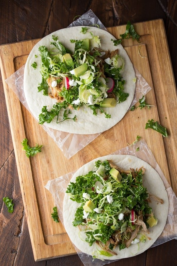 Slow Cooker Maple Pulled Pork Tacos with Kale and Brussels Slaw, an easy weeknight dinner ready in 20 minutes when using slow cooker maple pulled pork! @sweetpeasaffron