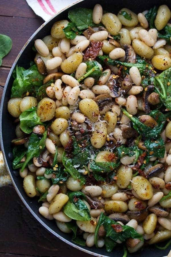 pan fried gnocchi with sundried tomatoes and white beans in large skillet
