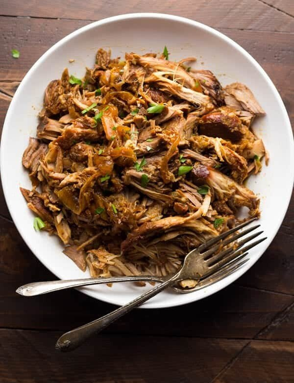 slow cooker maple pulled pork in white bowl with forks