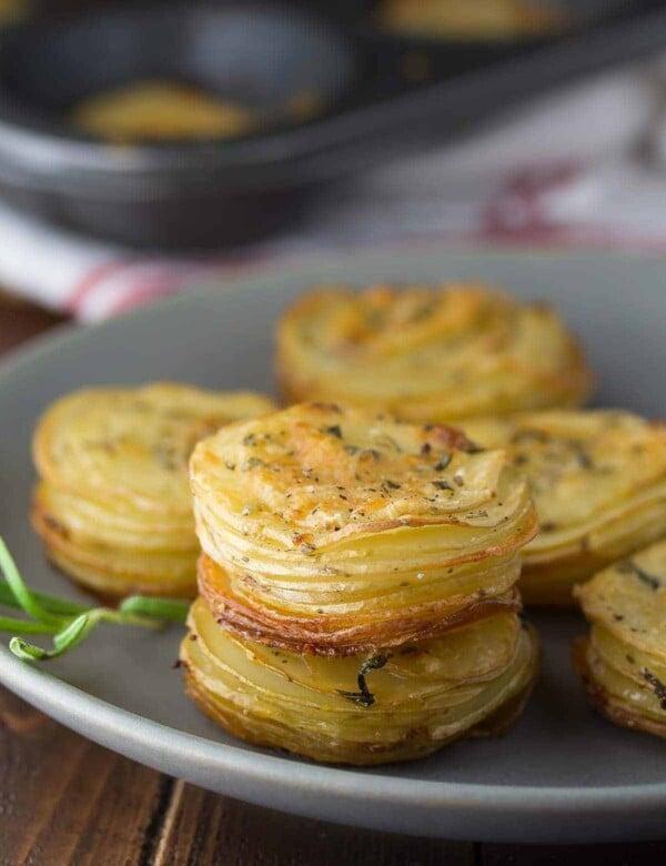 parmesan potato stacks on gray plate