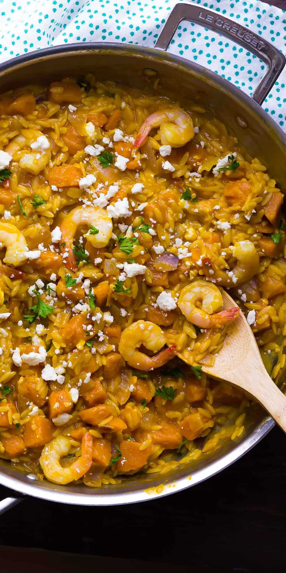 overhead shot of shrimp and squash orzo in skillet