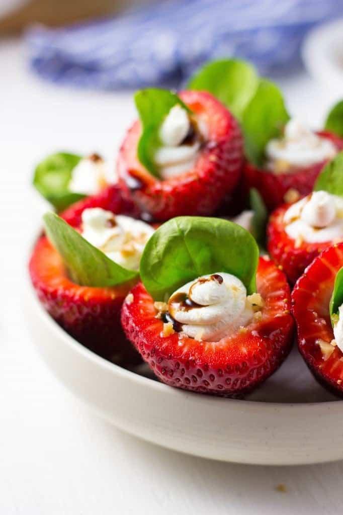 goat cheese stuffed strawberries in bowl