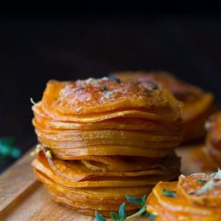 herb coconut oil sweet potato stacks on wood board