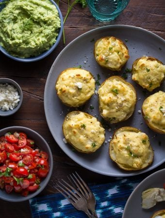 overhead shot of breakfast potato skins on gray plate with sides