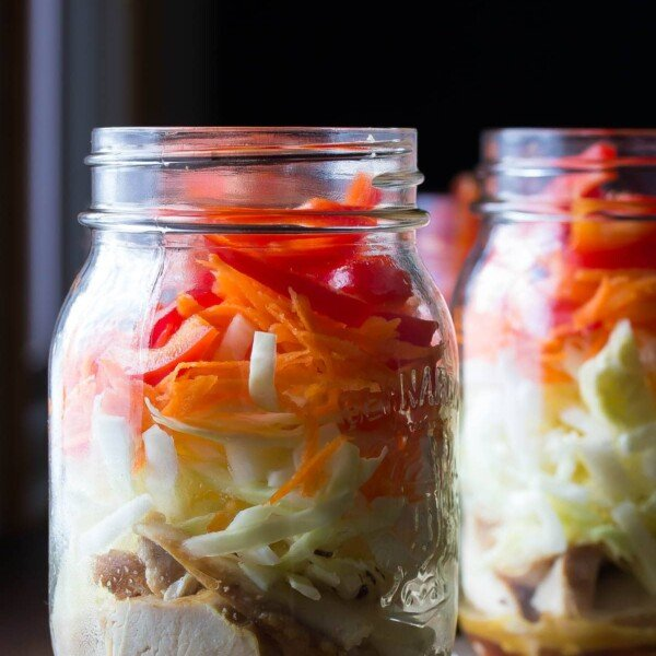 two mason jars filled with asian chicken salads