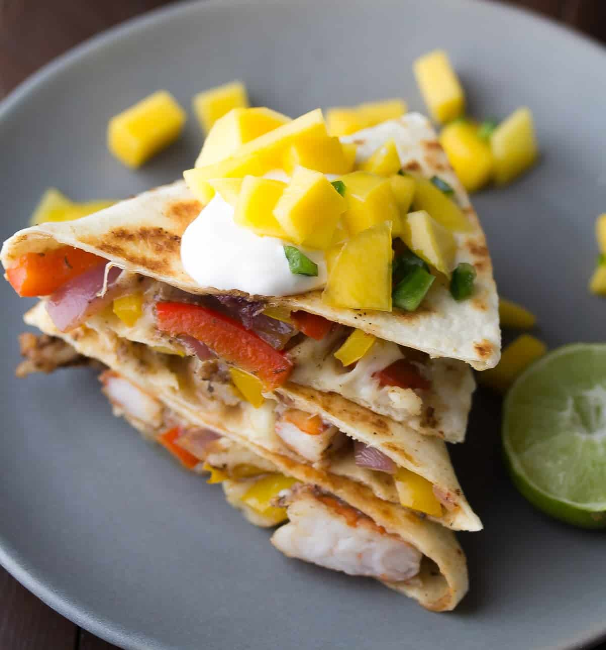 Spicy Shrimp Quesadillas with Mango Salsa, a delicious 30 minute dinner recipe that has a ton of fresh fruit and vegetables!
