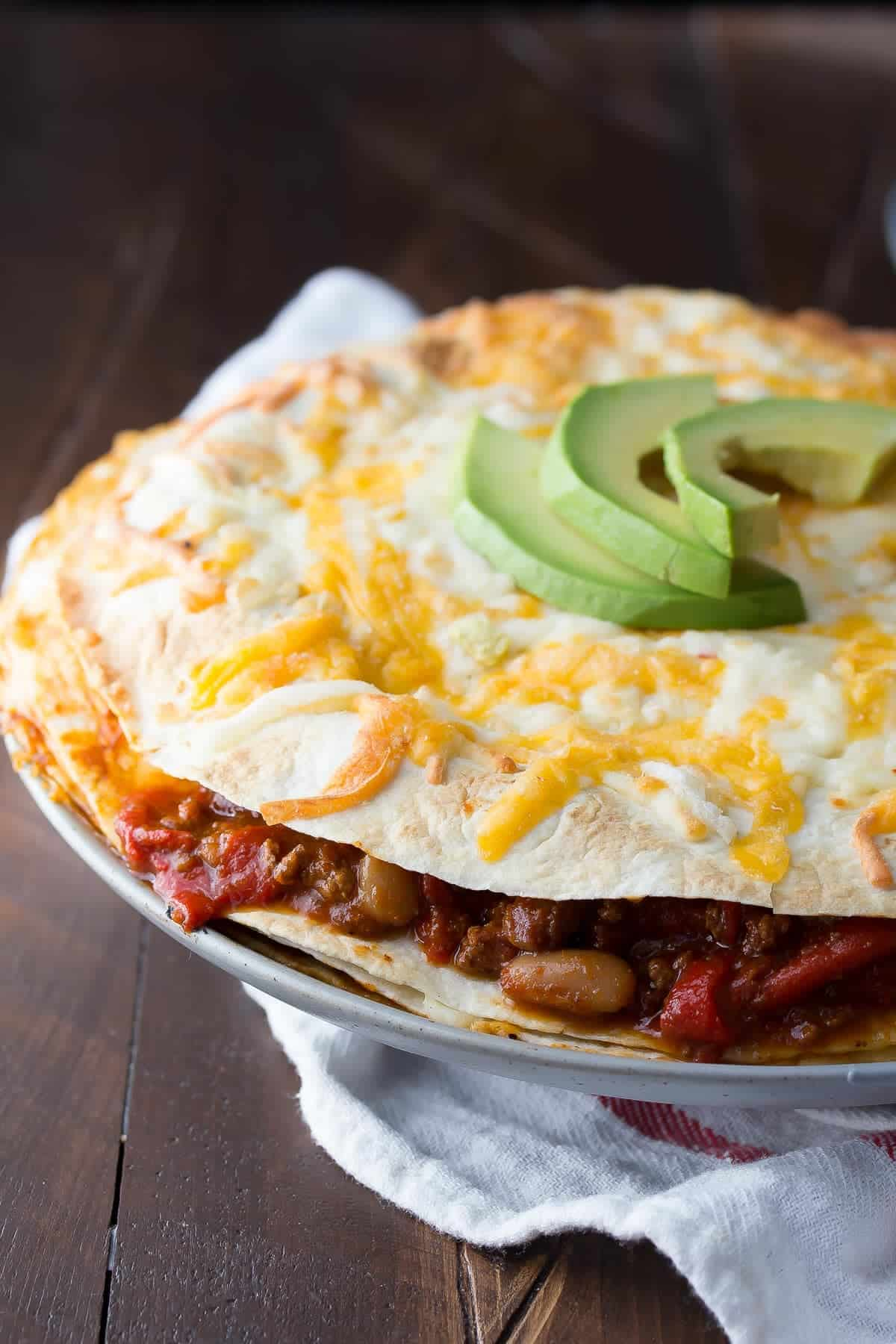 A fast and easy tortilla stack recipe that spreads leftover chili between tortillas with cheese.