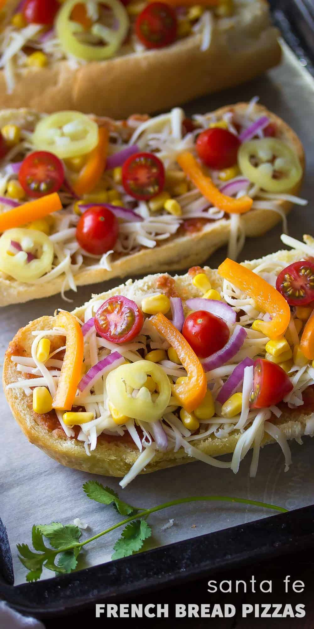 Santa Fe French Bread Pizza, topped with salsa, corn, chiles, peppers, tomatoes and cheese! Ready in under 30 minutes!