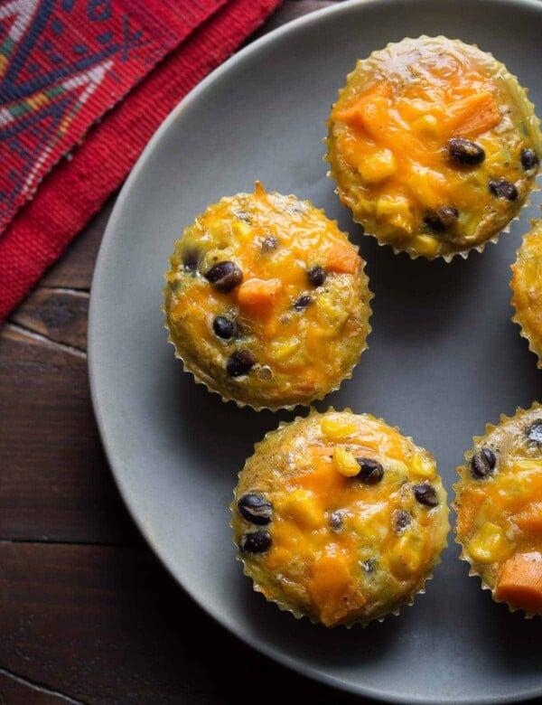 five southwestern sweet potato egg muffins on gray plate