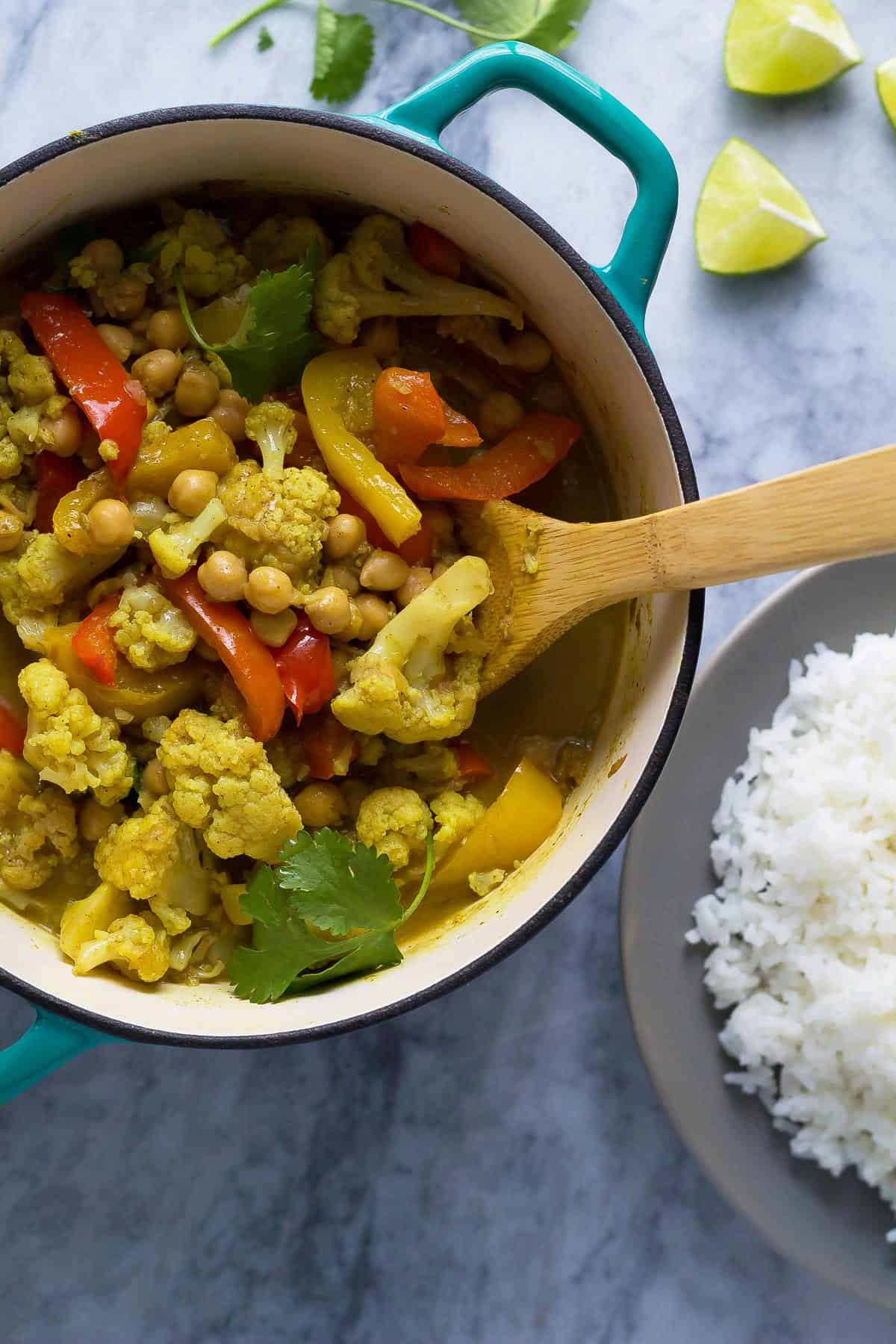This chickpea & cauliflower vegan curry is bright and flavorful, and is easy enough for a week-night dinner!