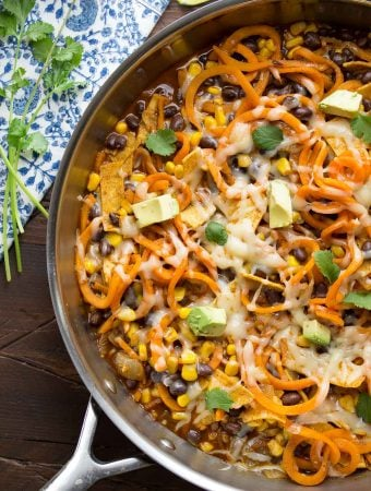 overhead shot of enchilada sweet potato noodles skillet in large pan on table