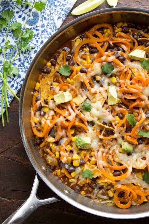 overhead shot of enchilada sweet potato noodles skillet in large pan on table
