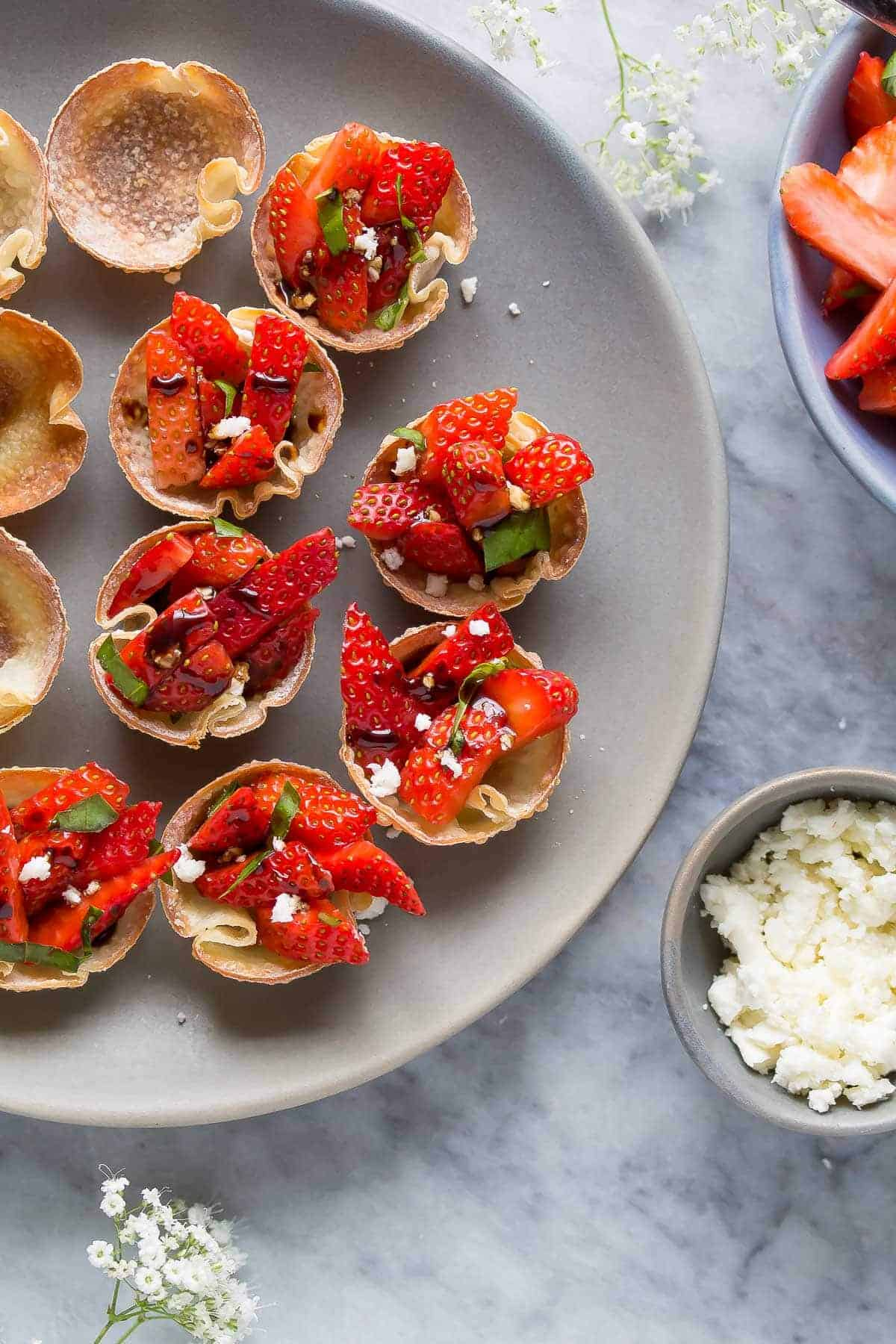 Balsamic Strawberry Bites with Feta and Basil, a lighter make-ahead appetizer option for a party or shower!