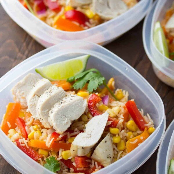 Meal prep containers filled with chicken fajita lunch bowls