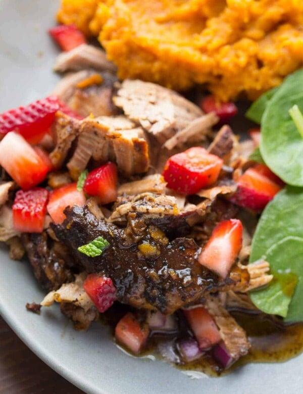balsamic pork tenderloin with sweet potatoes and strawberry salsa on gray plate