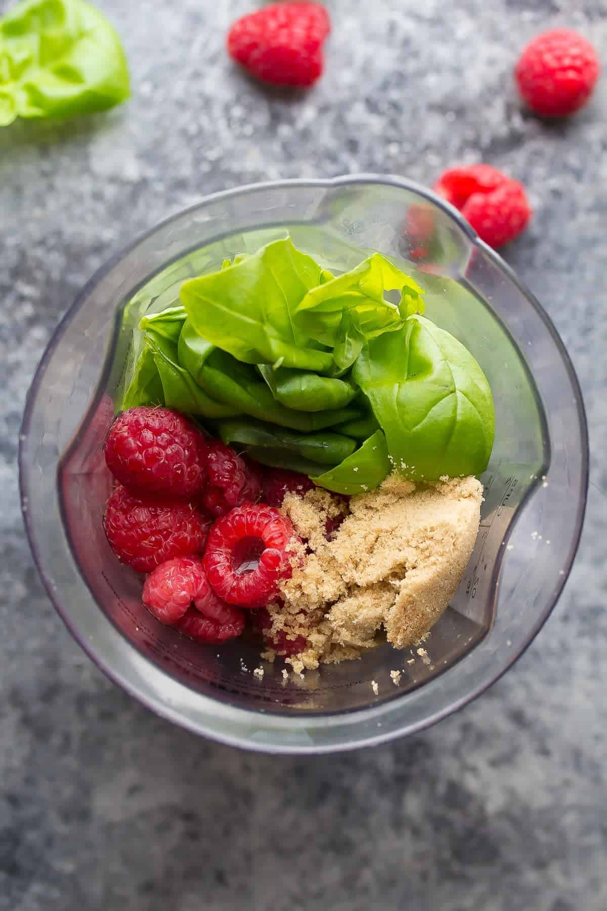 This Raspberry Basil Vinaigrette is ready in 3 minutes, contains a full cup of raspberries, and no oil! A delicious, healthier salad dressing option.