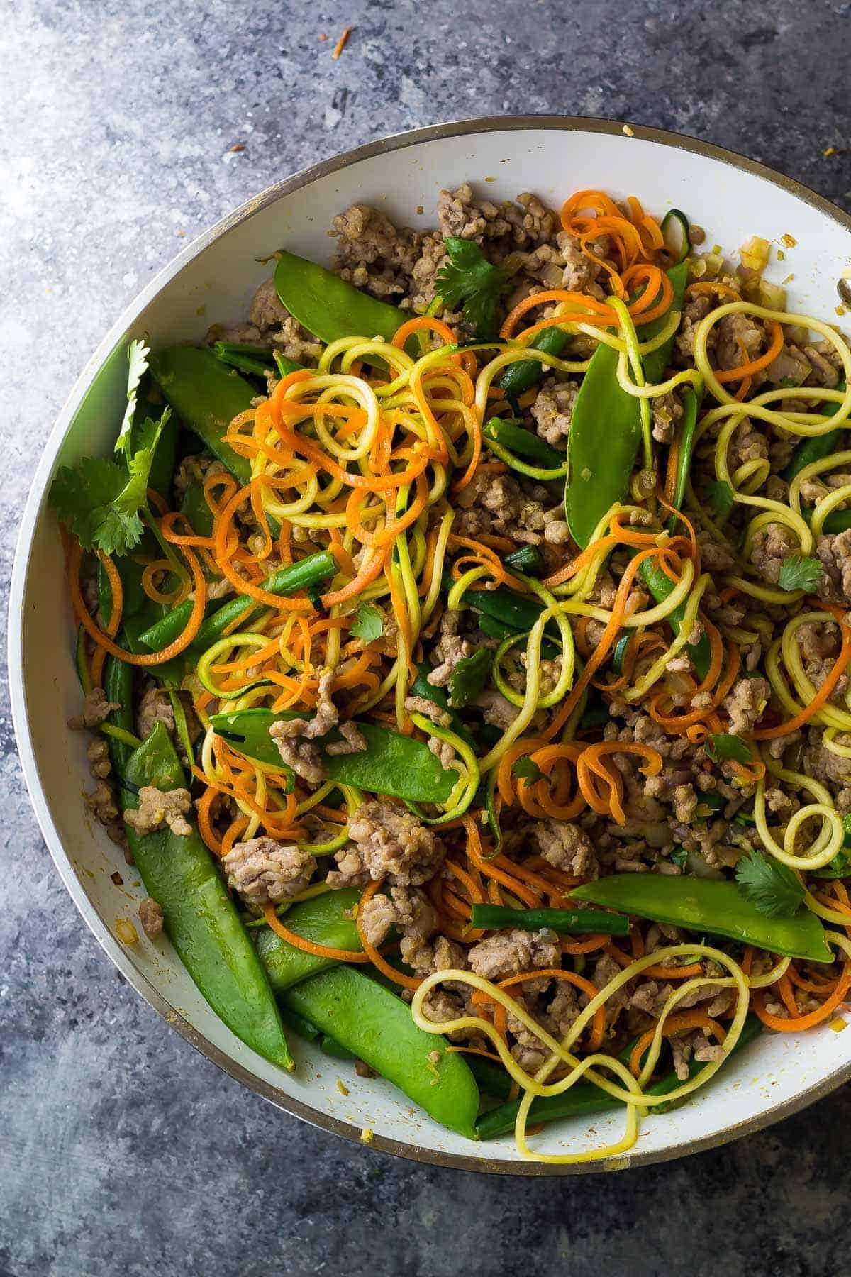 Lemongrass Thai Ground Pork Stir Fry in a skillet