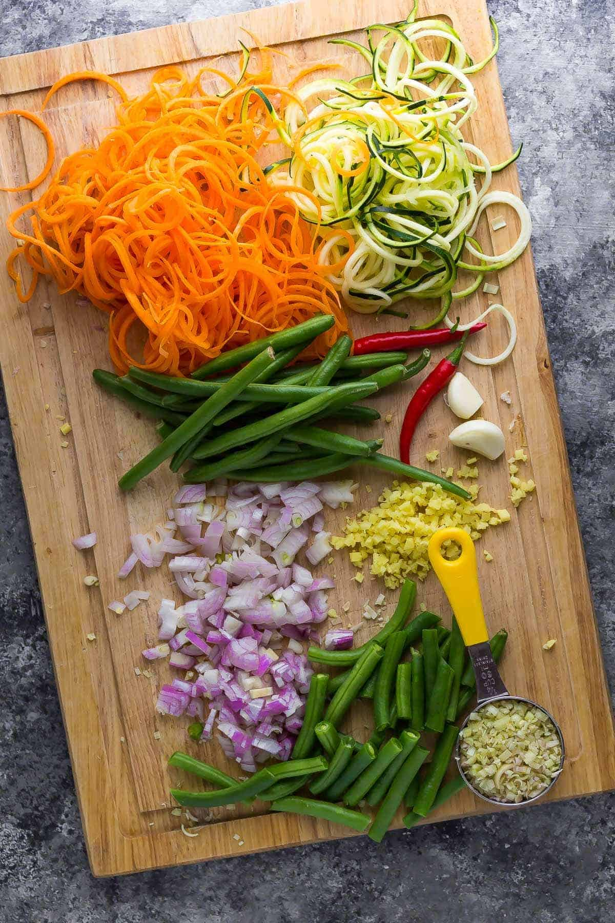 Chopped and prepared stir fry vegetables on a chopping board