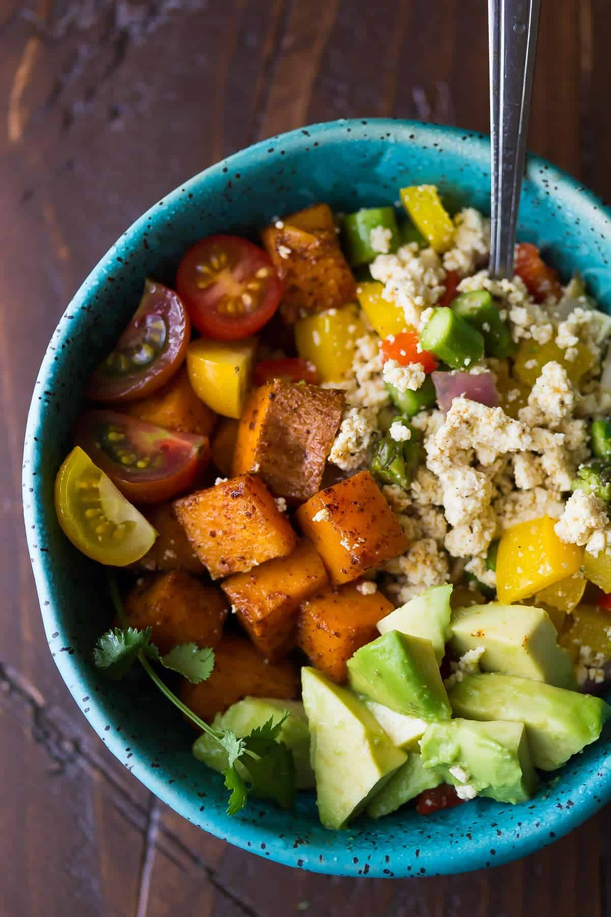 Tofu Scramble & Breakfast Sweet Potatoes with avocado in a blue bowl