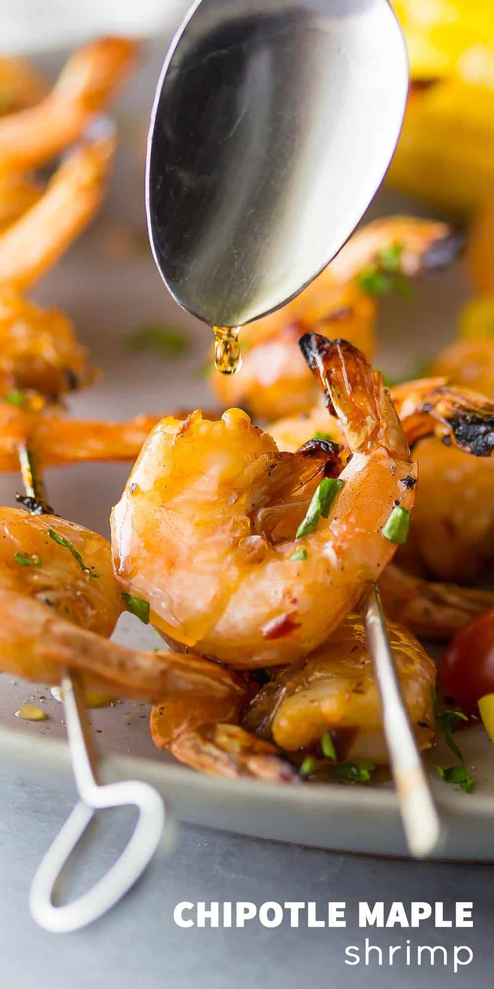 Chipotle Grilled Shrimp Skewers with Maple Glaze being drizzled over