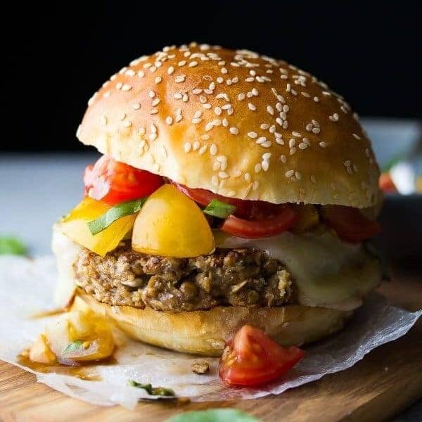 mushroom lentil bruschetta burger with bun on parchment