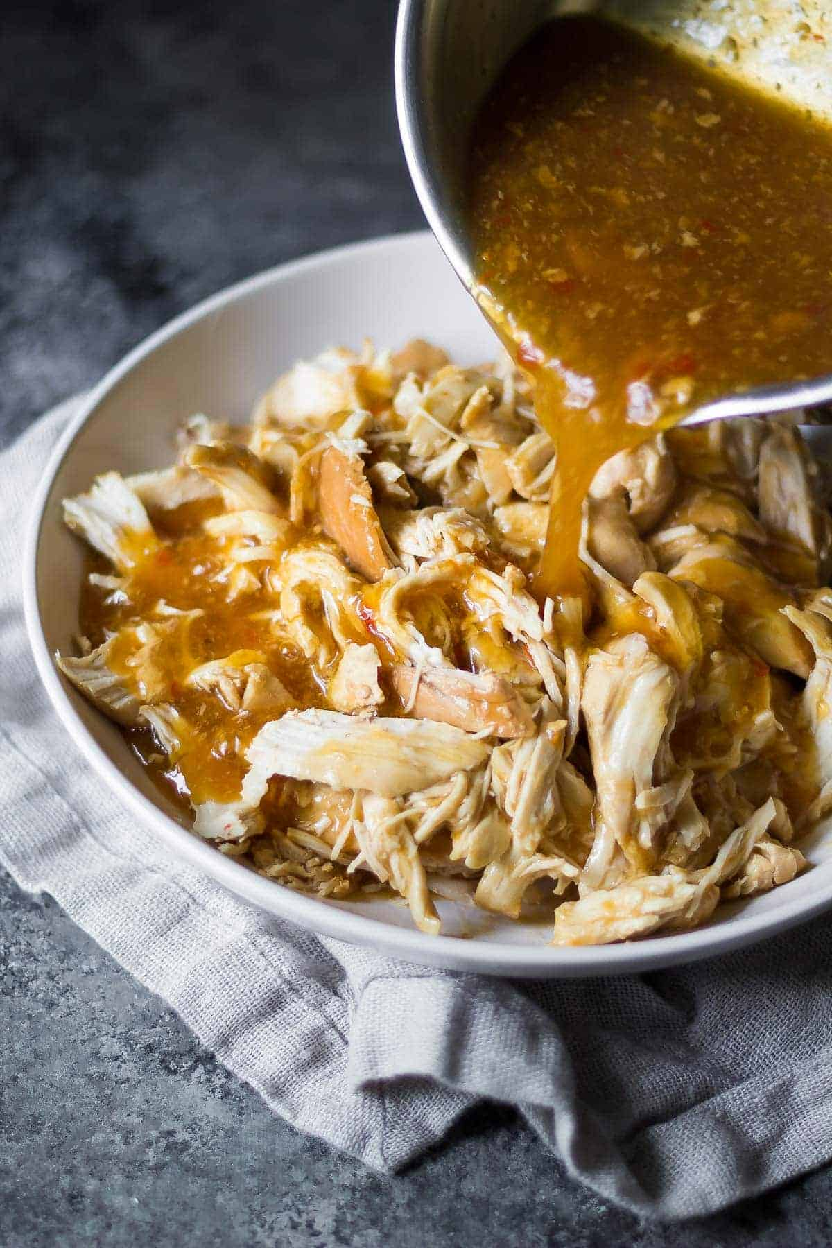 Remove the chicken and chop into pieces or shred into pieces, then return chicken to the slow cooker and give everything a few stirs. Stir in the cream cheese until fully melted and combined. Taste and add more salt or add ground black pepper to taste. Cover the .