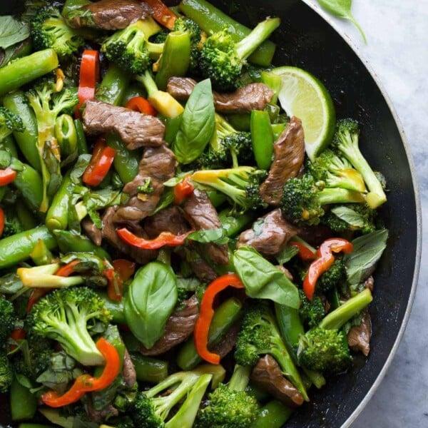 thai basil beef stir fry in large skillet