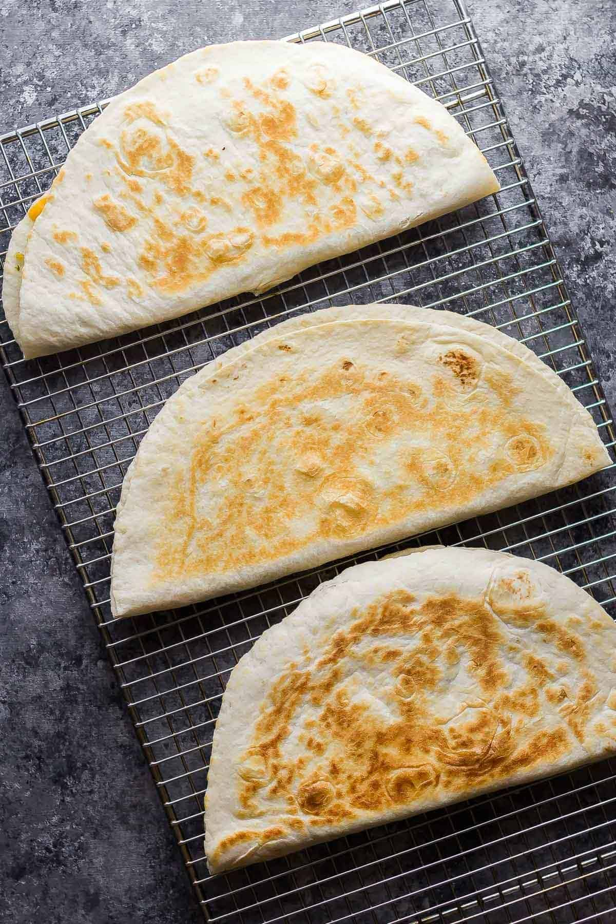 breakfast quesadillas cooling on wire rack