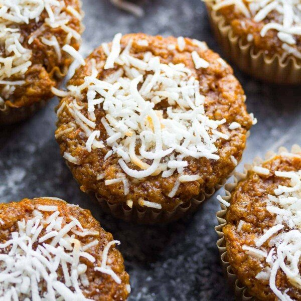 Coconut and carrot muffins on a gray background